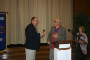 Bob Flynn receiving his gavel as new club president from District 11 Lieutenant Governor Chuck Bianchi.