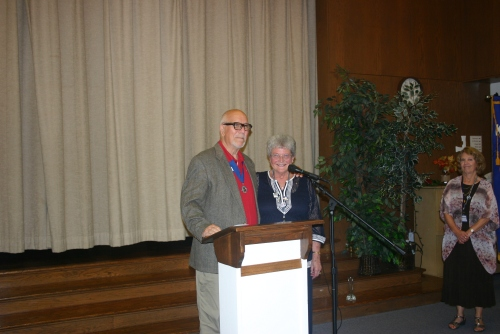 District 11 Lieutenant Governor Chuck Bianchi installing Joan VanArsdalen as club secretary.
