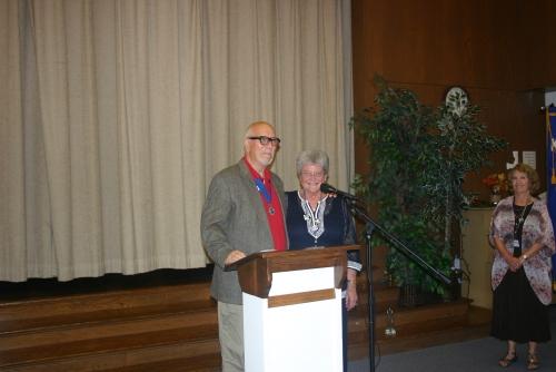 District 11 Lieutenant Governor Chuck Bianchi installing Joan VanArsdalen as club secretary.