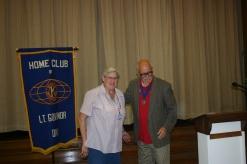 District 11 Lieutenant Governor Chuck Bianchi installing Sue Caulkins as club treasurer.