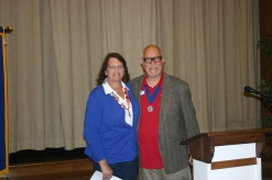 District 11 Lieutenant Governor Chuck Bianchi installing Beth Caswell as club president elect.